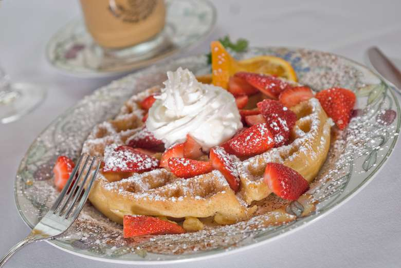Breakfast Special of strawberries and waffle with whipped cream