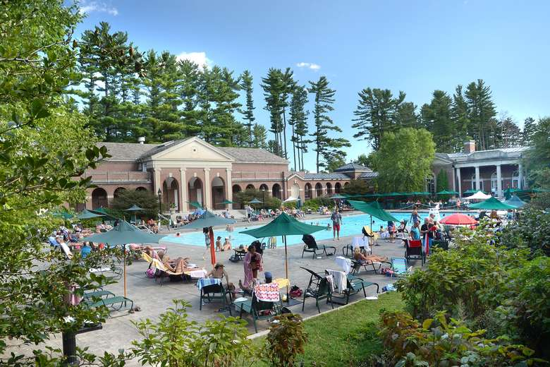 people around an outdoor pool