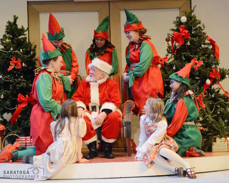 santa with five elves and two little girls