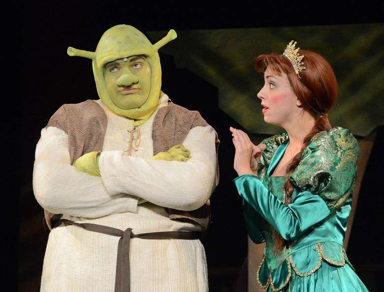 actors portraying shrek and princess fiona acting on stage