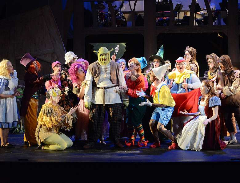 cast of shrek the musical performing on stage