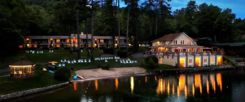 chelka lodge property at night seen from the water