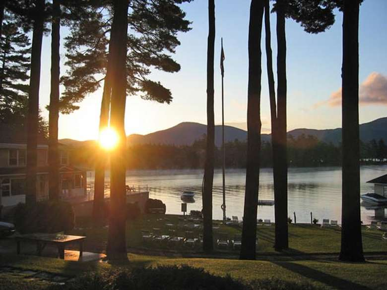 view of sunrise over lake george from chelka lodge property