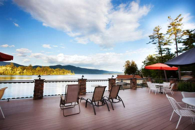 deck area at chelka lodge overlooking lake george