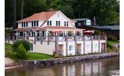 exterior of chelka lodge from the water