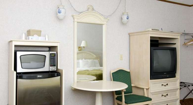 motel room seating area, television cabinet, mini-fridge, and microwave