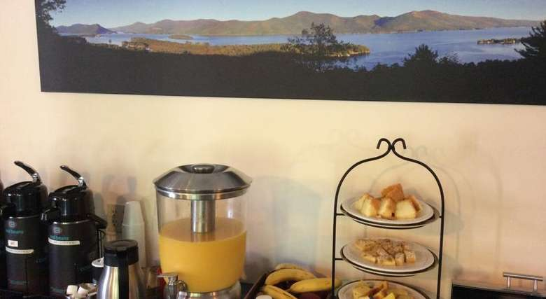 continental breakfast bar with coffee, orange juice, and pastries