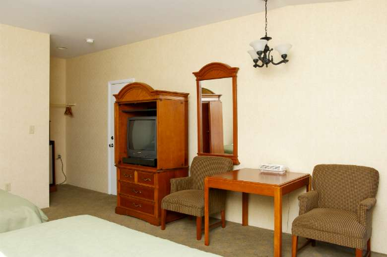 motel room seating area and television cabinet