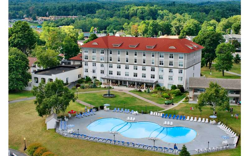 Grand hotel aerial view with pool