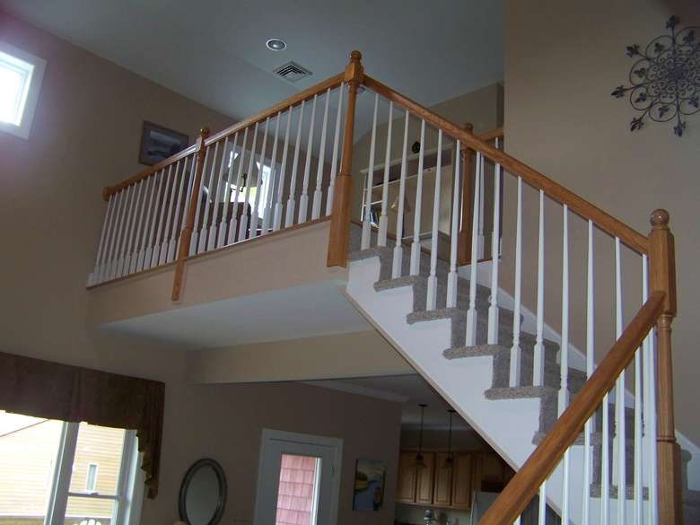 a staircase that goes up halfway, then turns to the left, and goes up to a landing