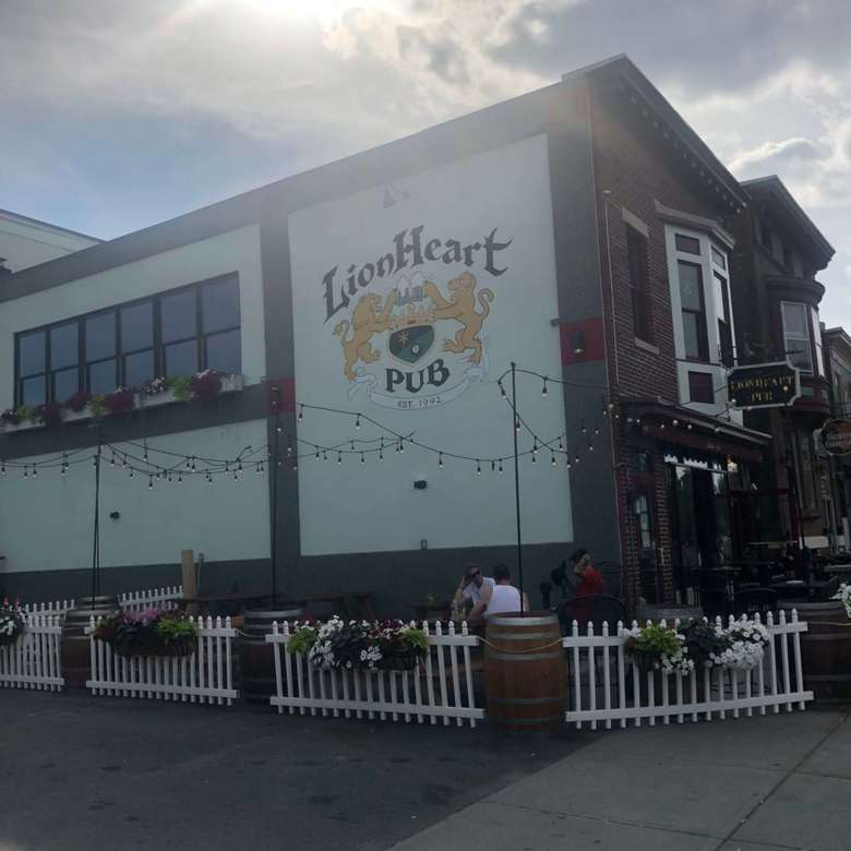 outside building with lionheart pub logo painted on exterior wall