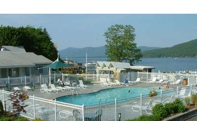 pool area at marine village resort with lake george in the background