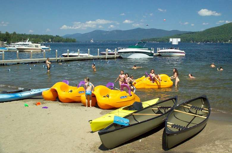 canoes, kayaks, and paddleboats on the beach