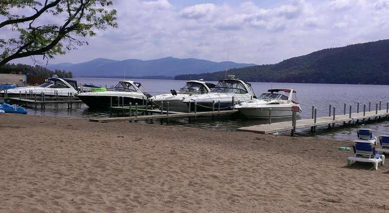 boats docked at marine village resort on lake george