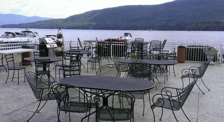 patio tables and chairs overlooking lake george