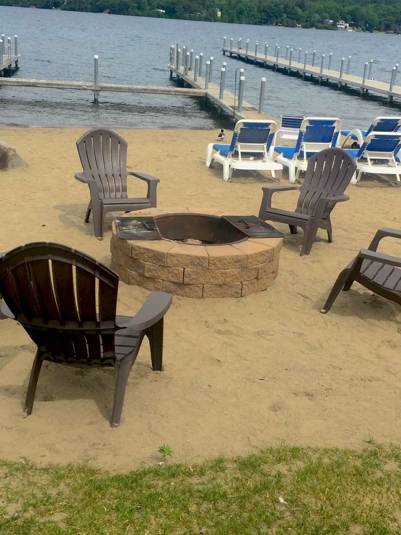 Adirondack chairs around a fire pit