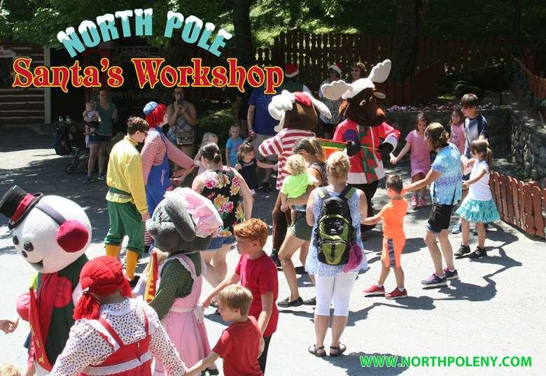 kids and cast members dancing at Santa's Workshop