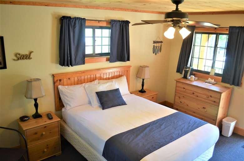 crisp, clean bedroom in off white and navy tones