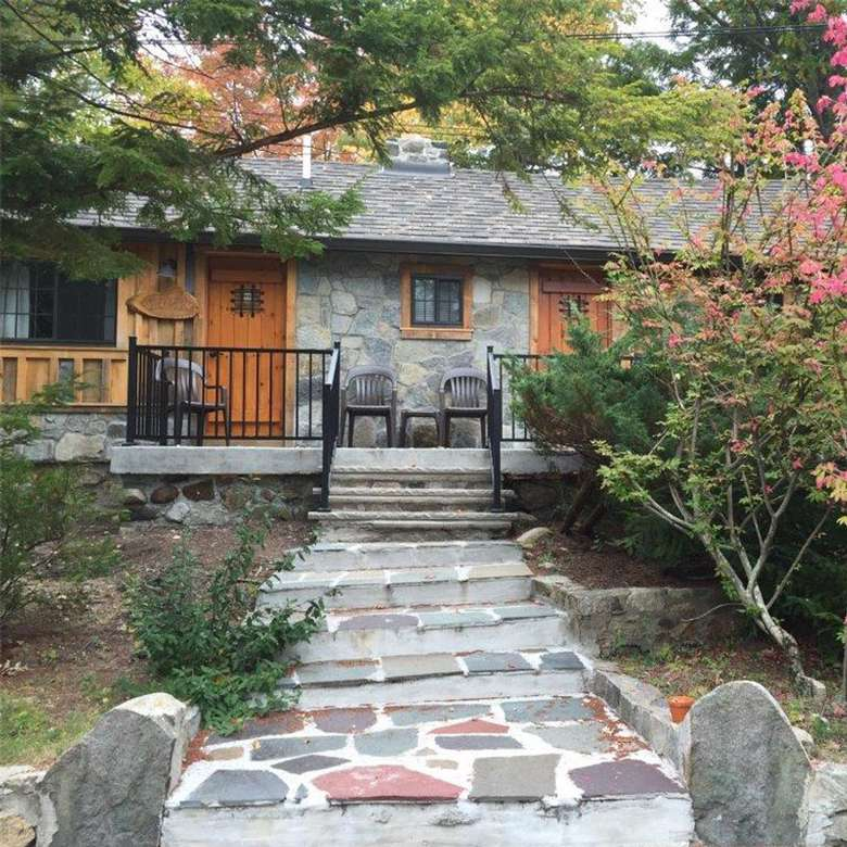 stone pathway leading up to cabin