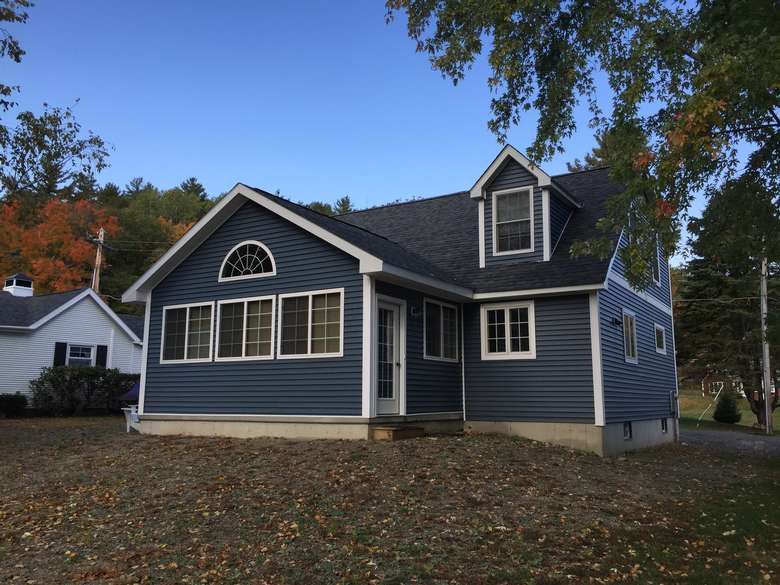 newly constructed home with navy blue siding
