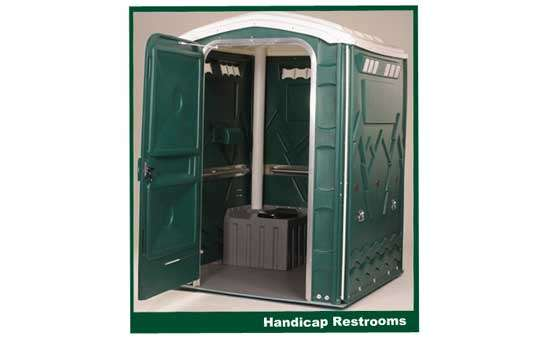 a large green handicap accessible portable restroom unit