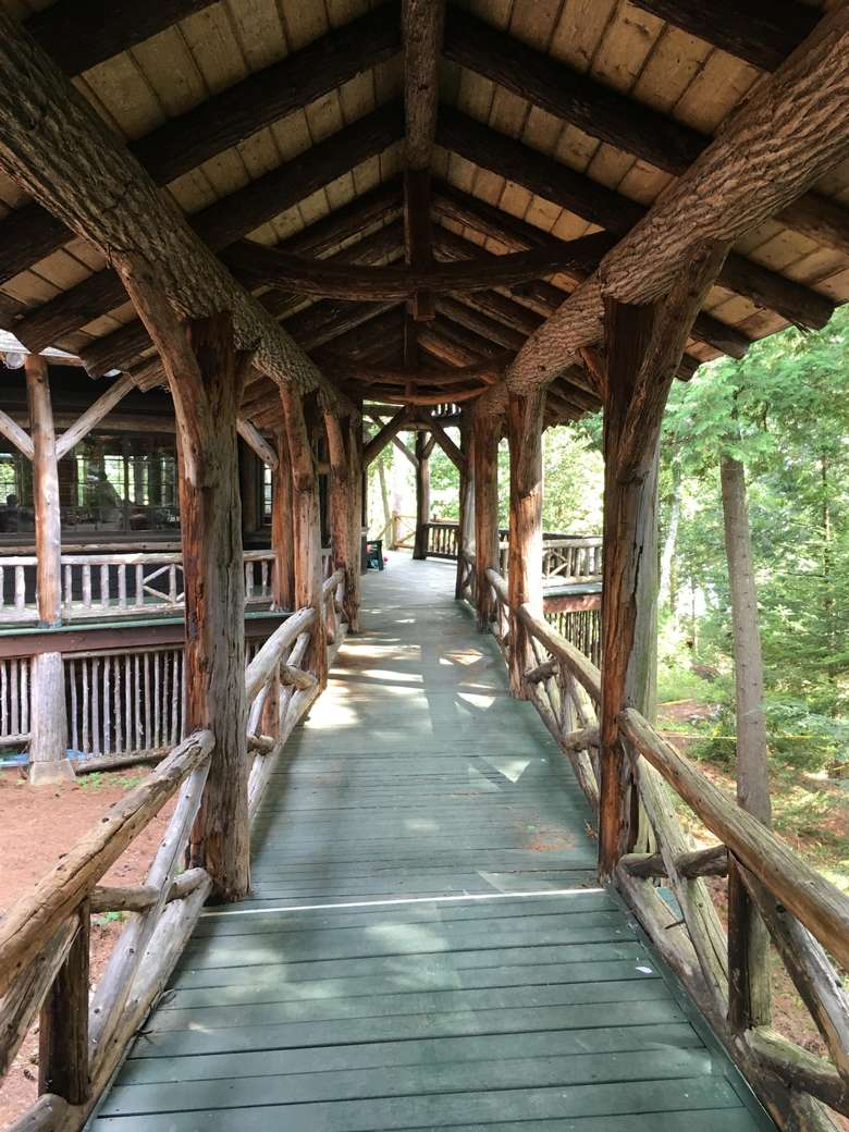 elevated wooden bridge connecting camp buildings