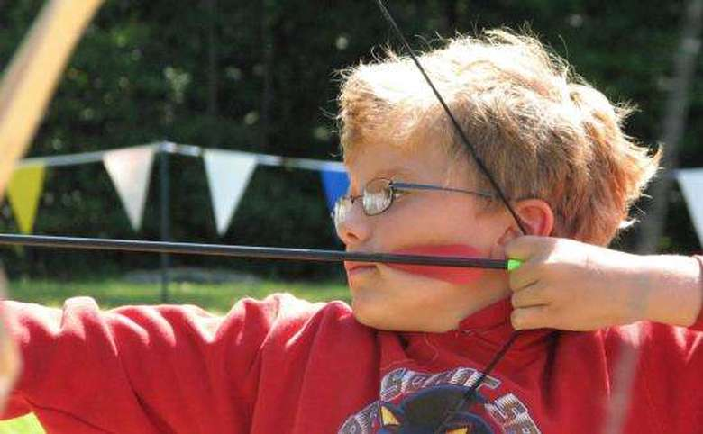 young boy practicing archery