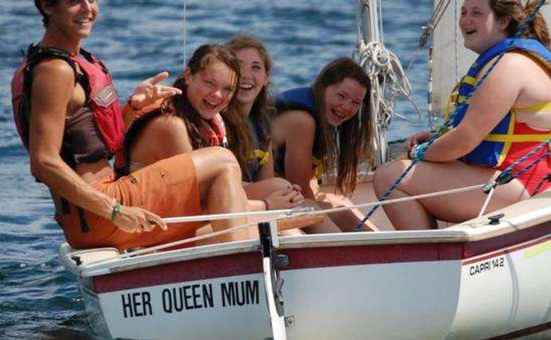 group of teenagers in a sailboat