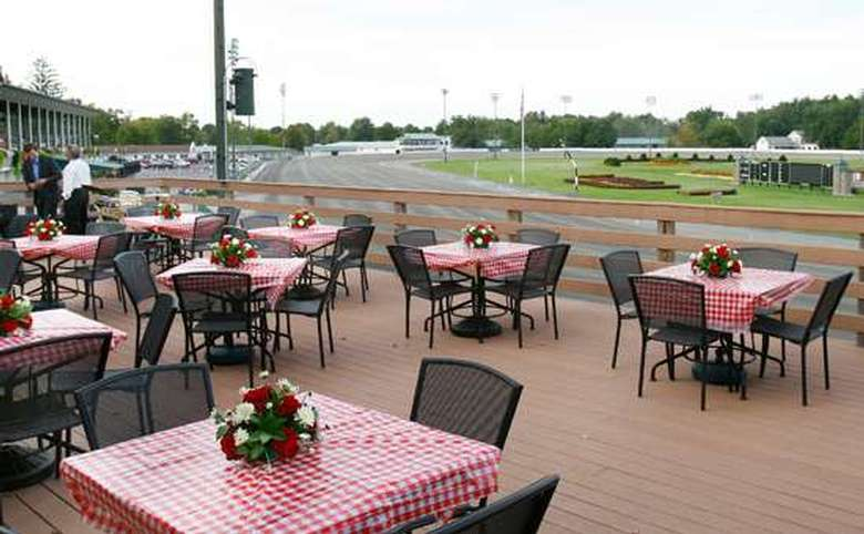 outdoor dining area alongside a harness racing track
