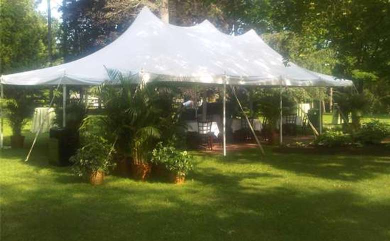 large white tent set up on a lawn