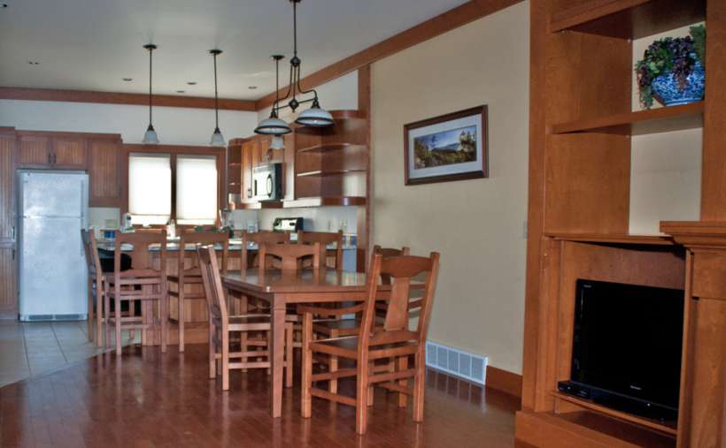 dining area with chairs at kitchen counter and separate table with chairs