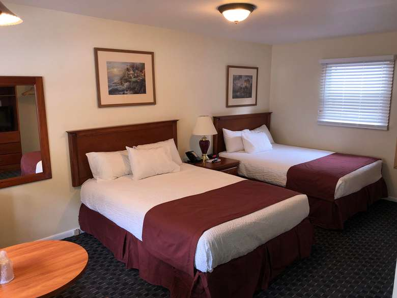 motel room with two queen beds