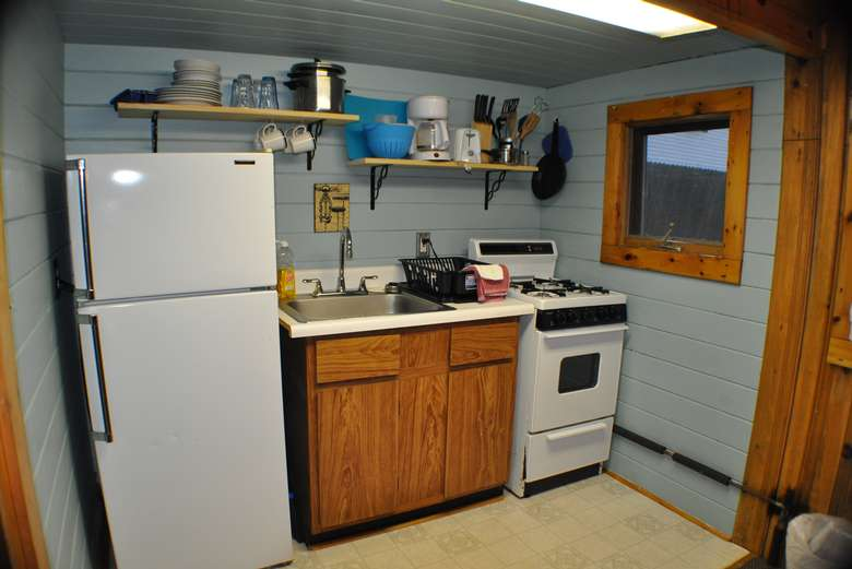 refrigerator, sink, stove