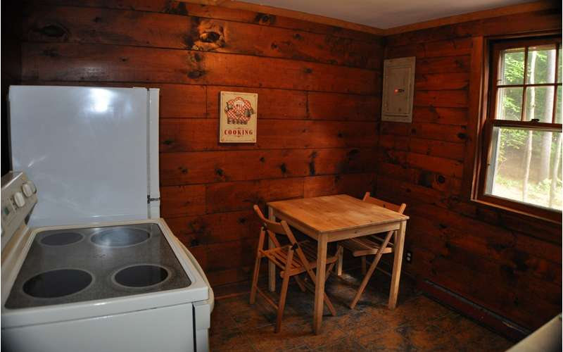 kitchen stove, refrigerator and table