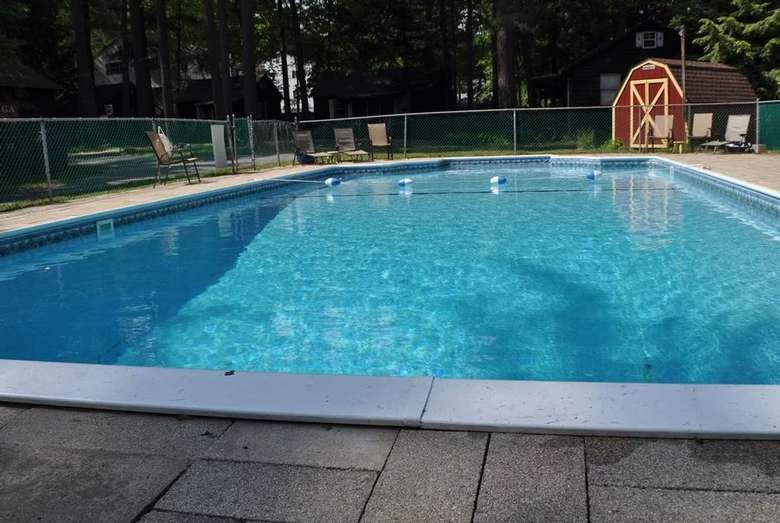 a large outdoor pool with buoys