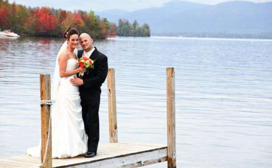 Couple on dock in wedding attire