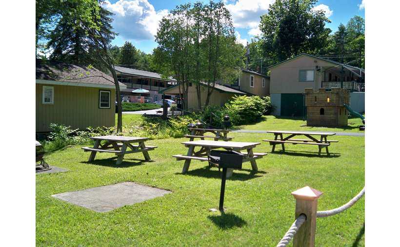 picnic tables on grass, cottages
