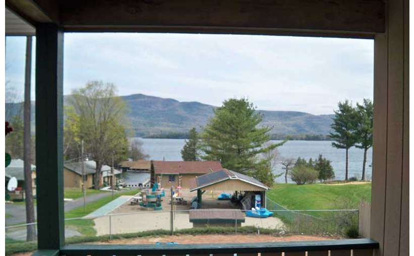 view of resort and lake from a window