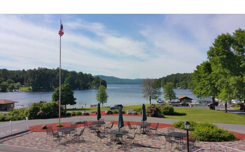 the large patio and tables in front of Dunham's Bay Resort on Lake George