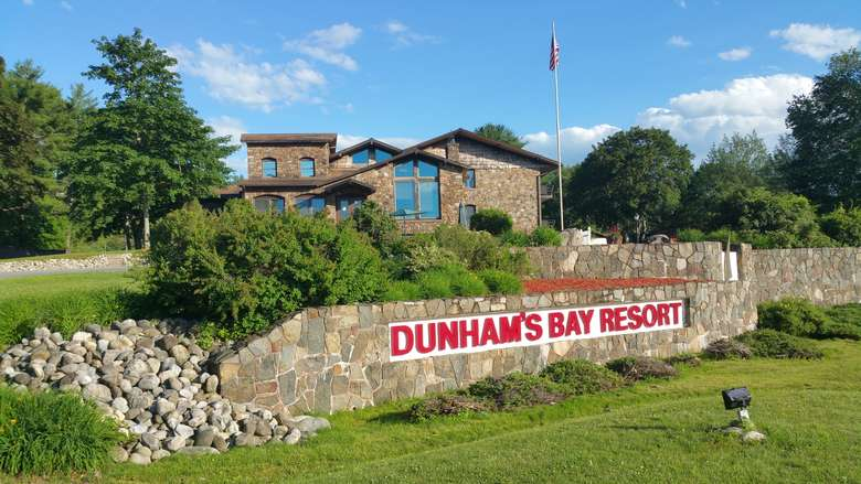 the stone entrance sign at Dunham's Bay Resort