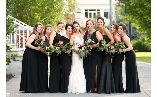 Bride and Bridesmaids standing together smiling