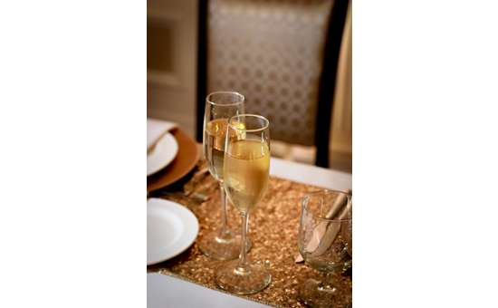 Flukes of champaign on golden placemats