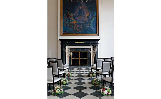 chairs facing fireplace and large painting