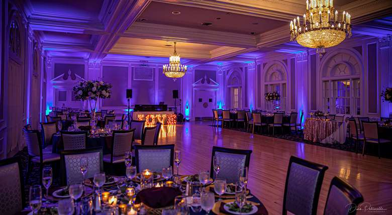 ballroom at the queensbury hotel setup for a wedding
