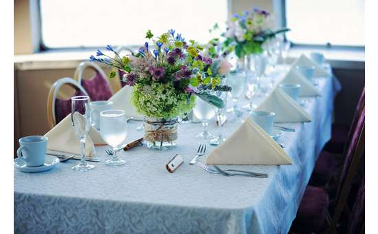 rectangular table set for eight with floral centerpieces