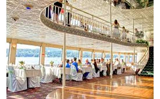 dance floor on a boat surrounded by tables