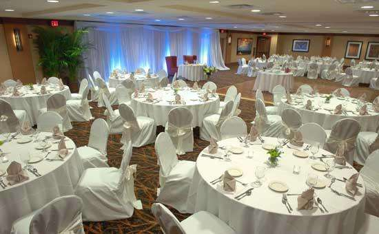 tables set up for a wedding with white linens and tablecloths