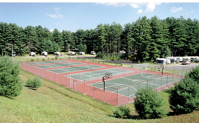 one basketball court and four tennis courts in a row