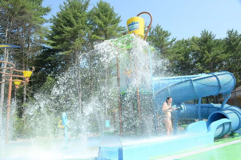 dump bucket on splash pad is dumping water