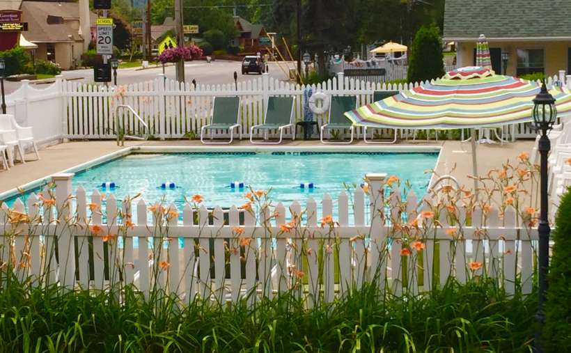 view of pool through fence